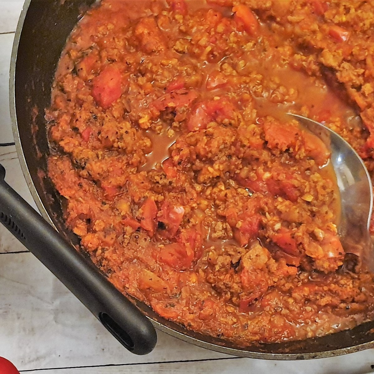 Close up of a pan of spaghetti bolognese sauce.