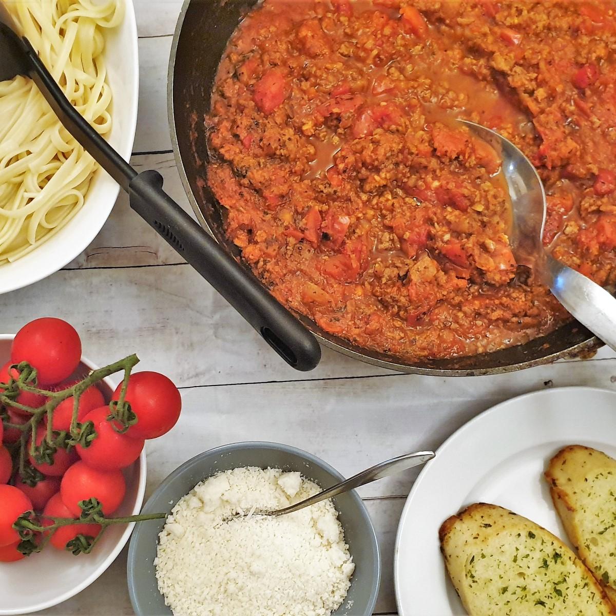 A pan of spaghetti bolognese sauce.