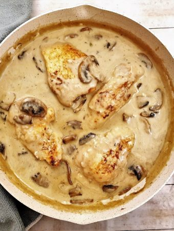 Overhead shot of chicken marsala in creamy mushroom sauce,i n a frying pan