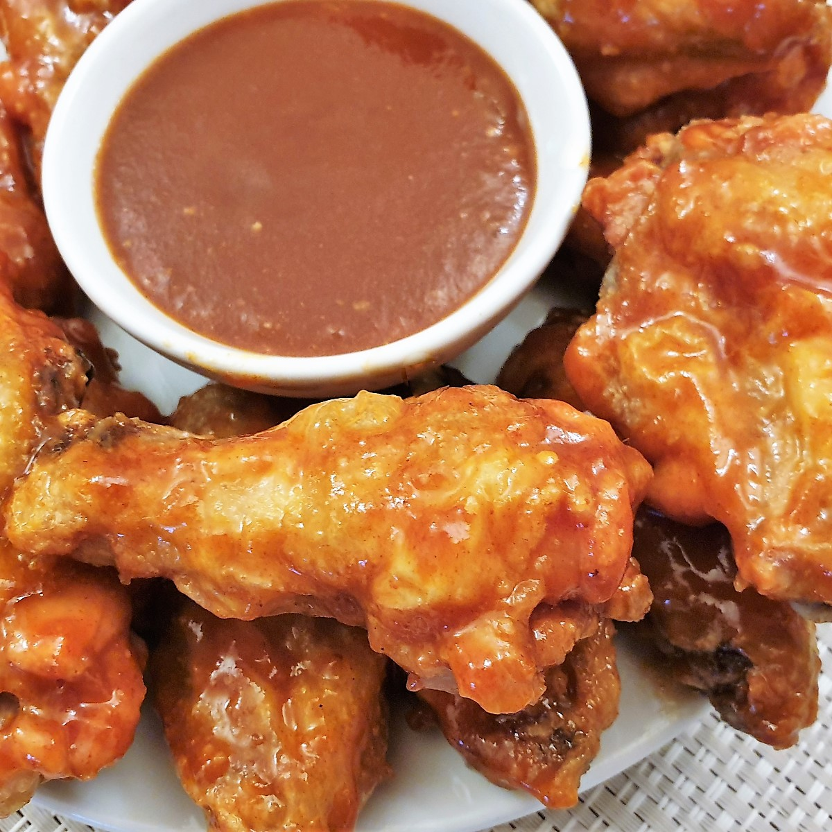 Close up of barbeque chicken wings.