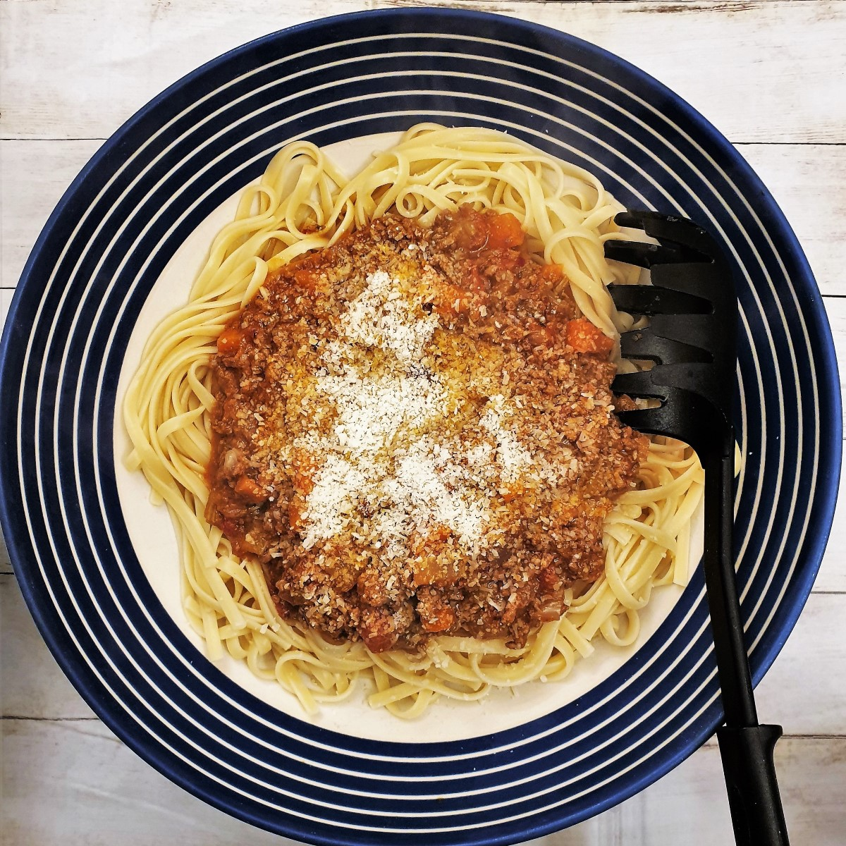 Over head shot of a serving bowl filled with lamb ragu.