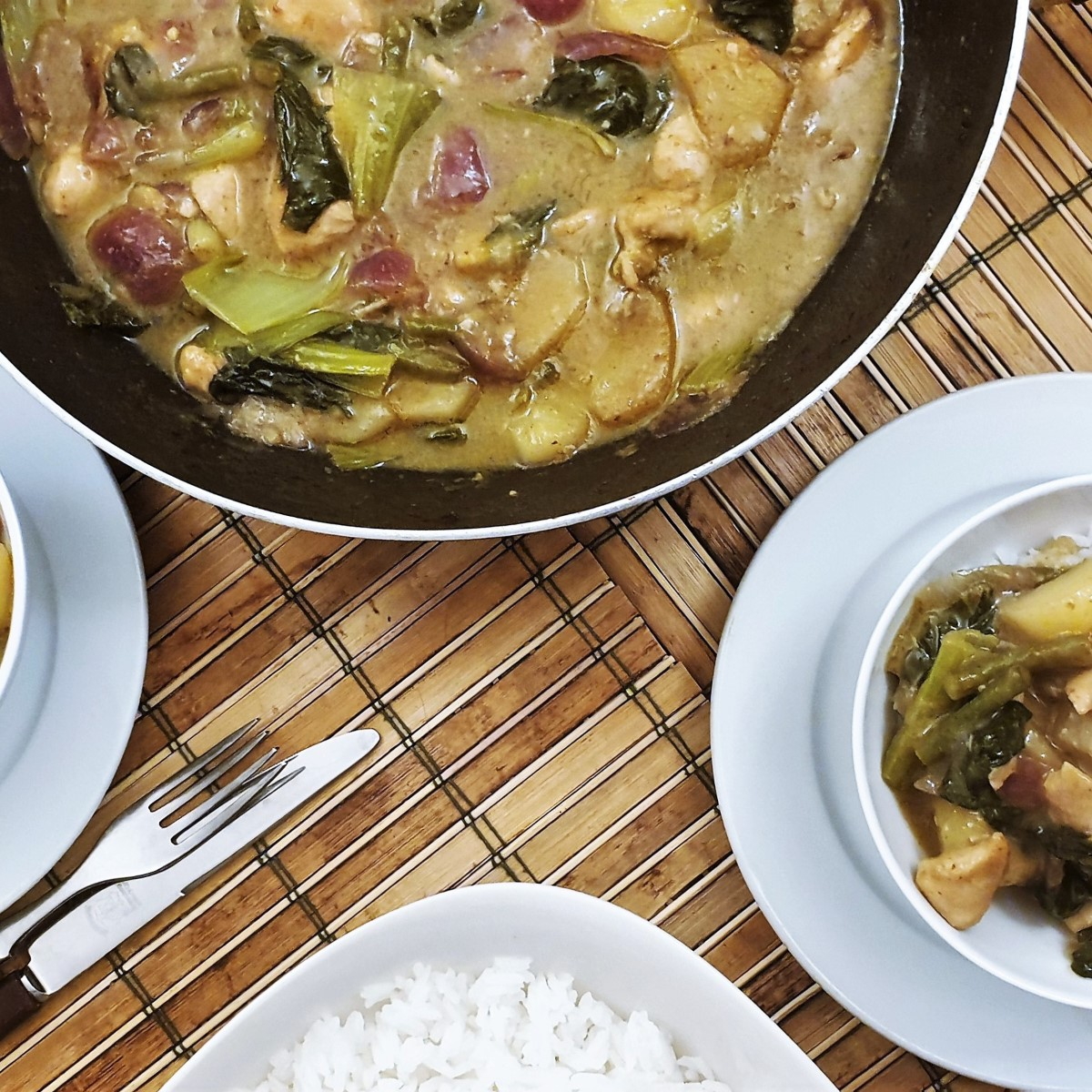 Overhead shot of a wok filled with thai green curry.