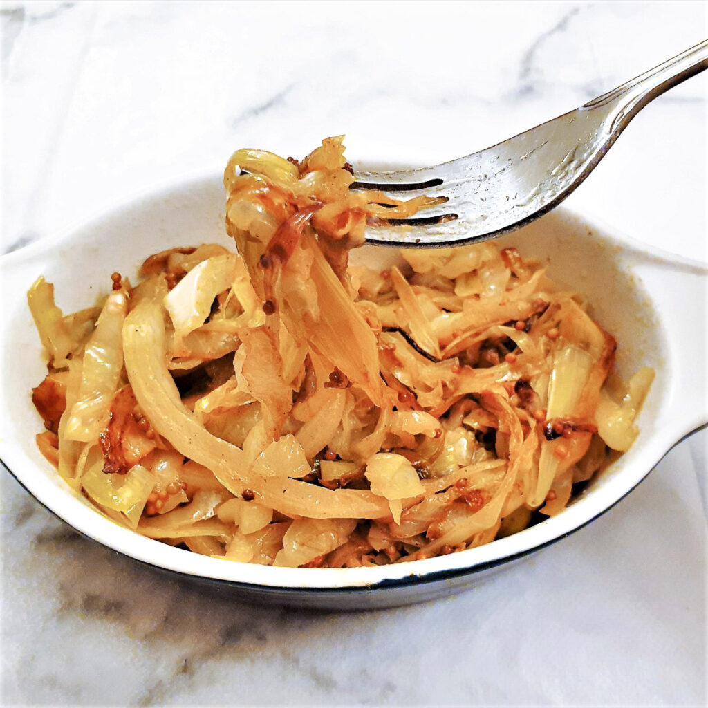 Buttered cabbage and leeks in a serving dish.