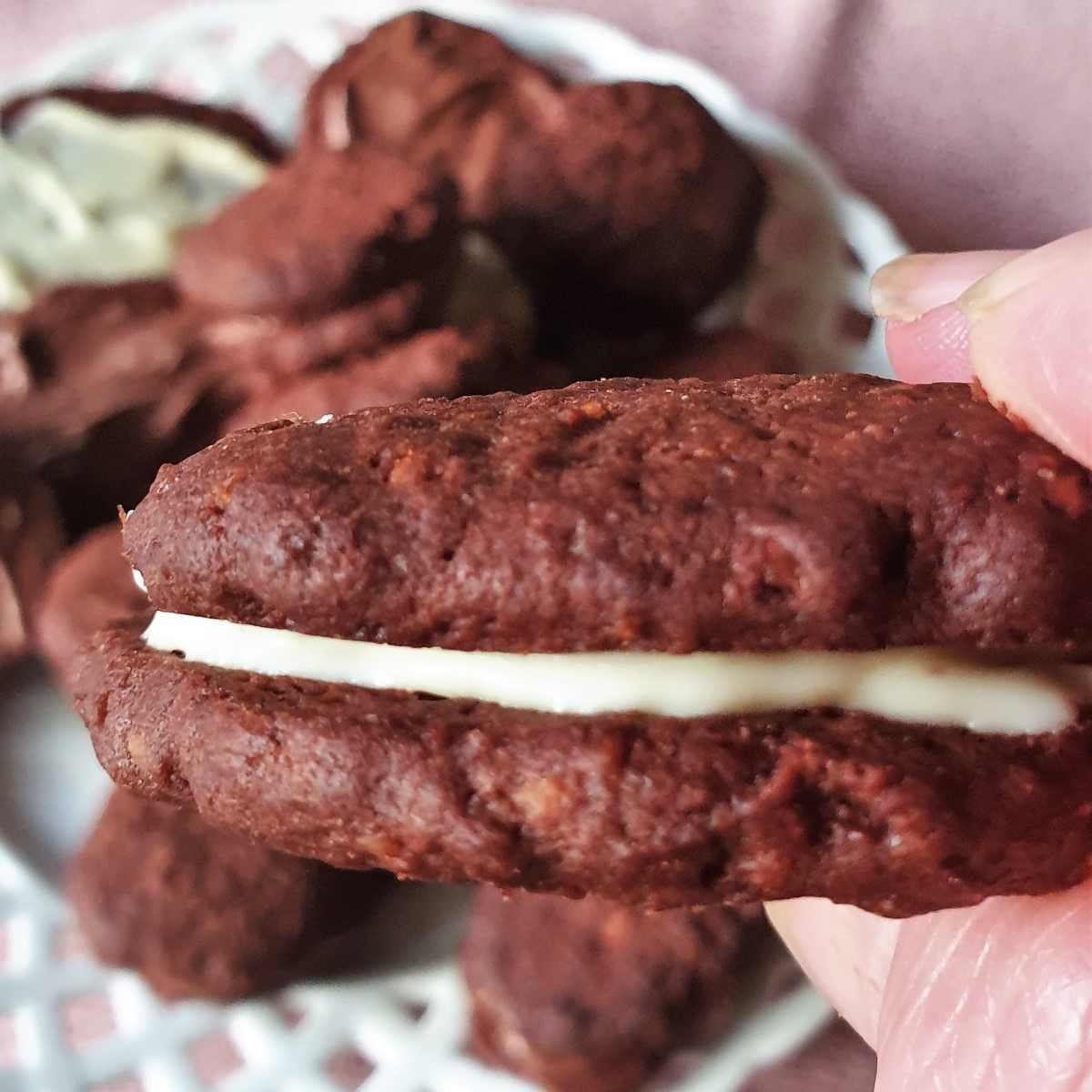A close up of a romany cream biscuit sandwiched with white chocolate.