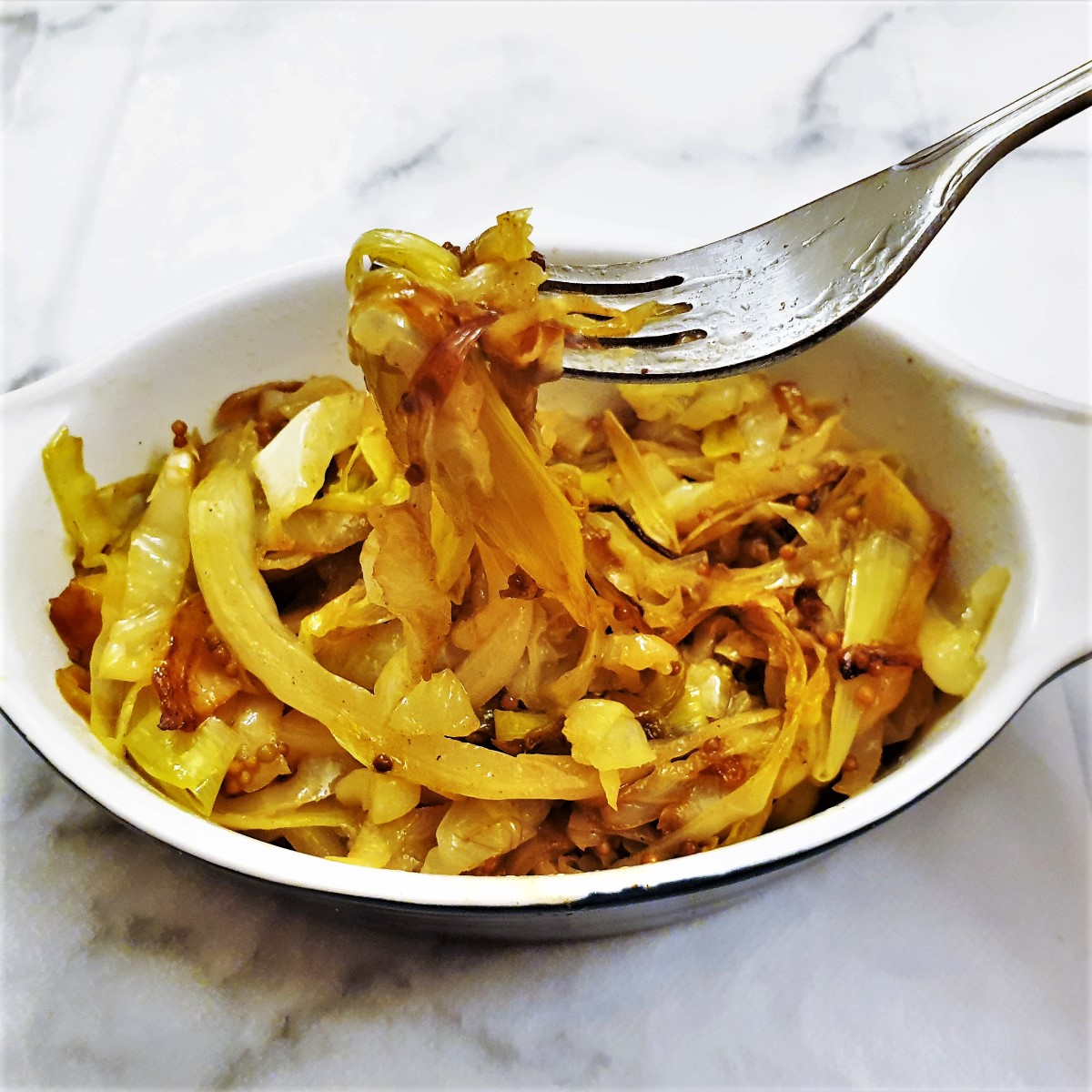 Sauteed cabbage and leeks in a dish.