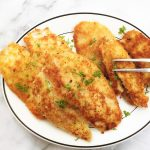 Fried chicken schnitzels on a plate.