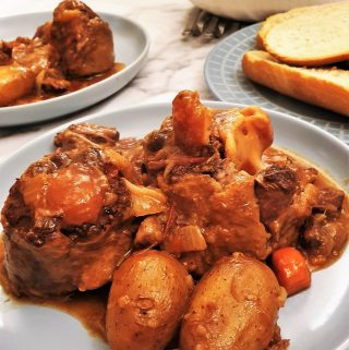 Closeup of a plate of oxtail stew.