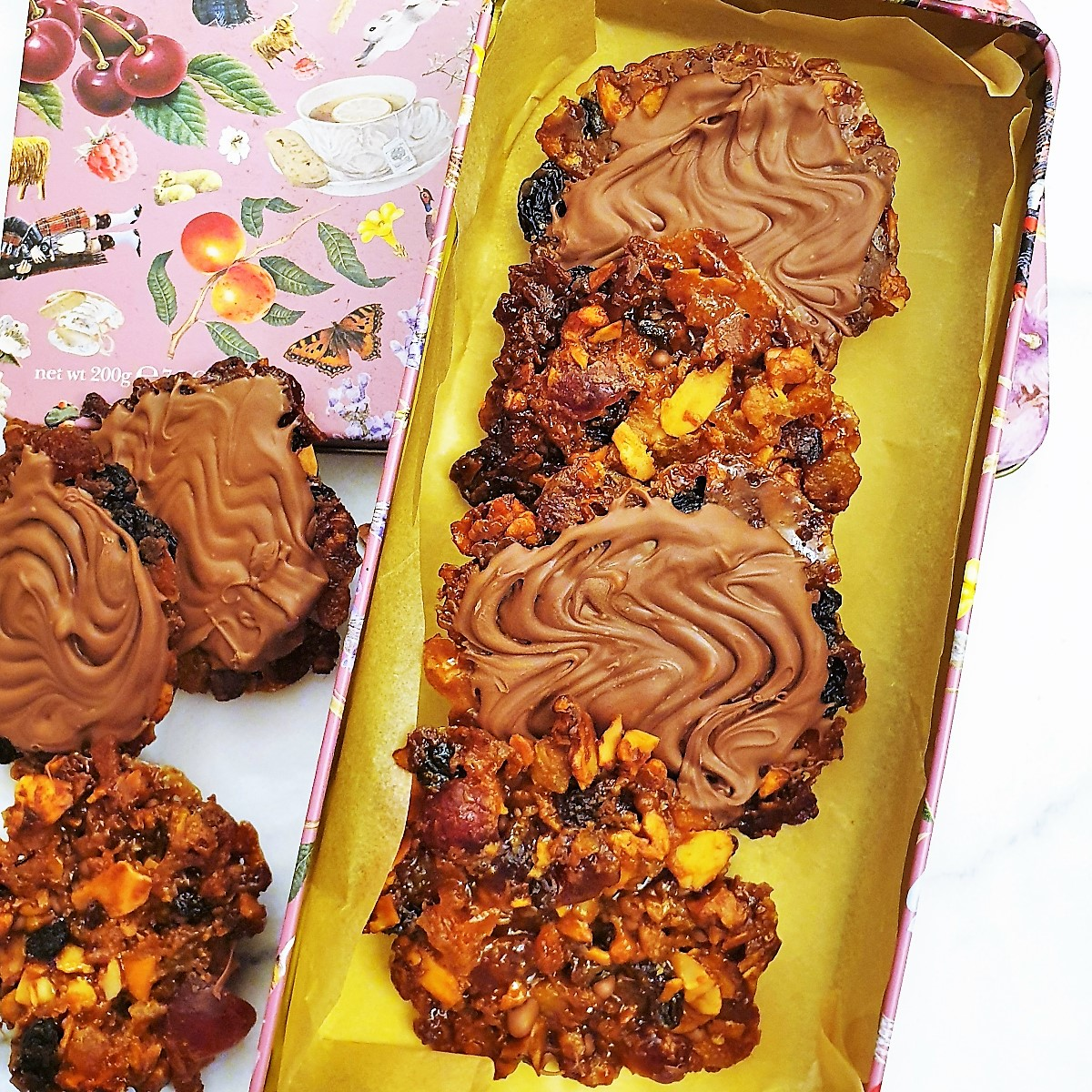 Chocolate florentines in a tin.