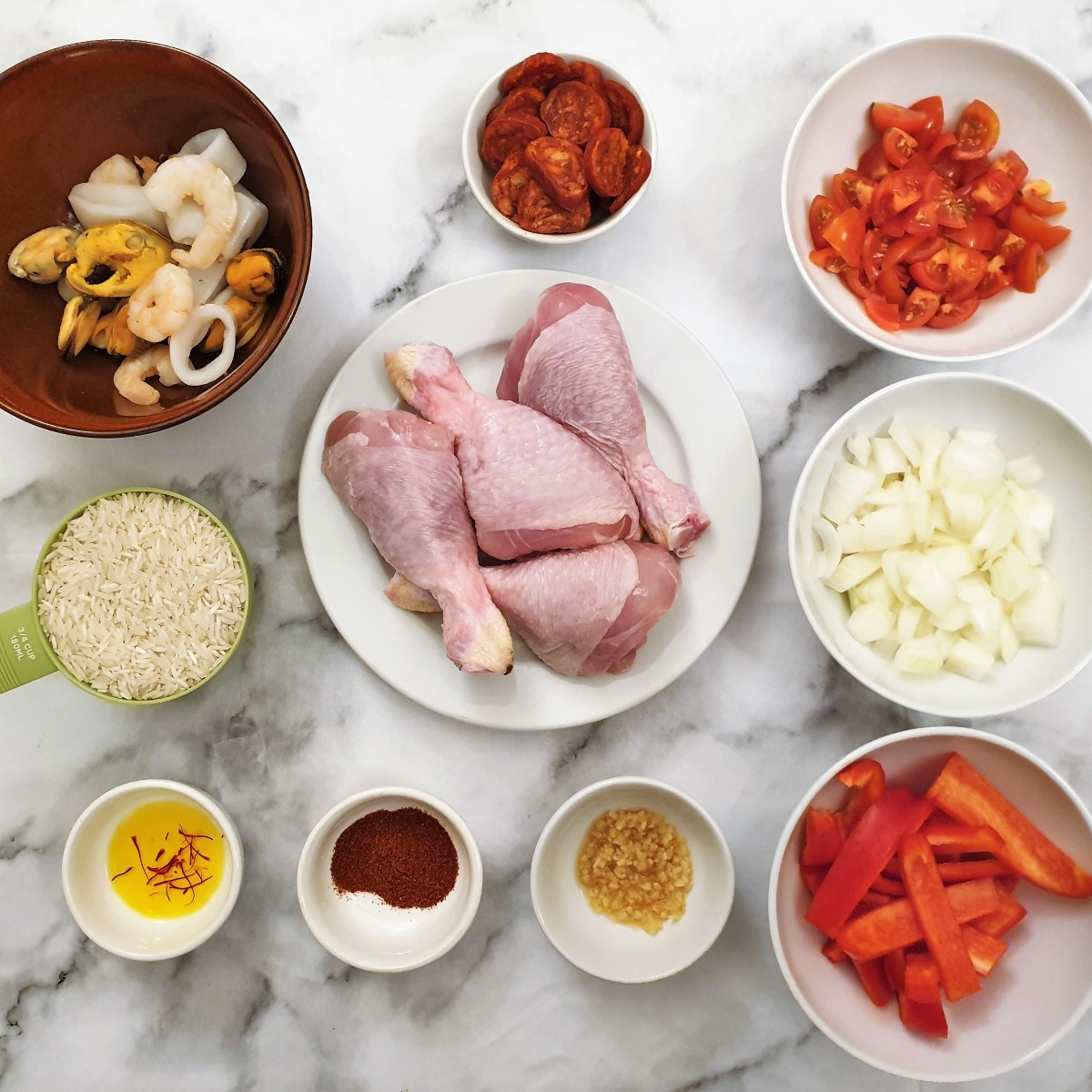 Ingredients for chicken and seafood paella.