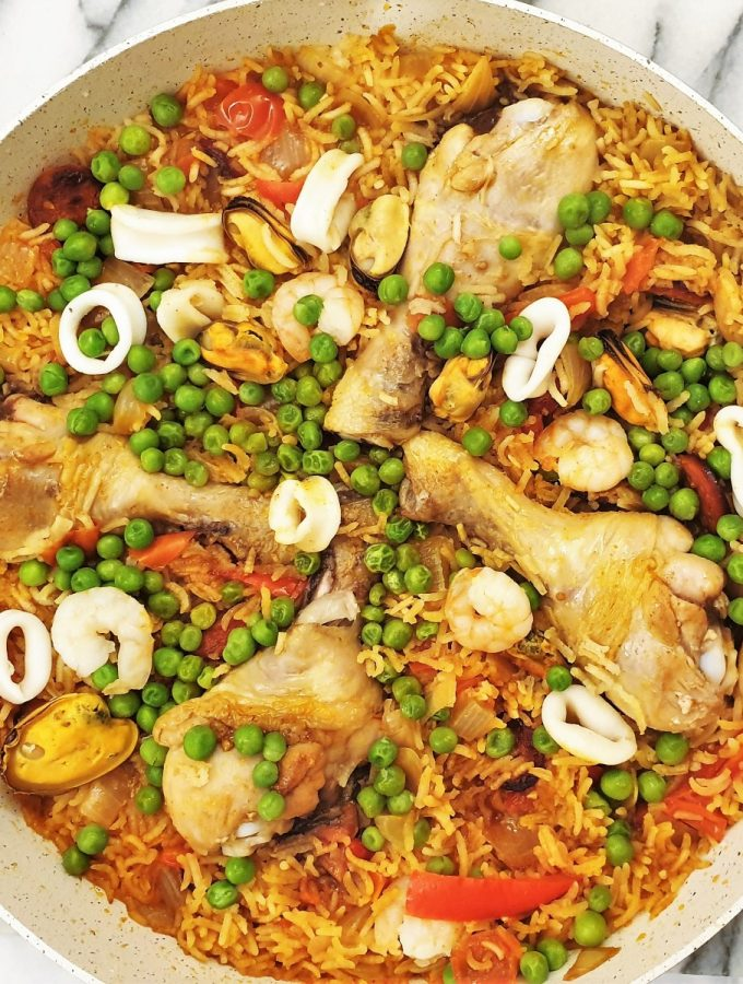Overhead shot of a pan of chicken and seafood paella.