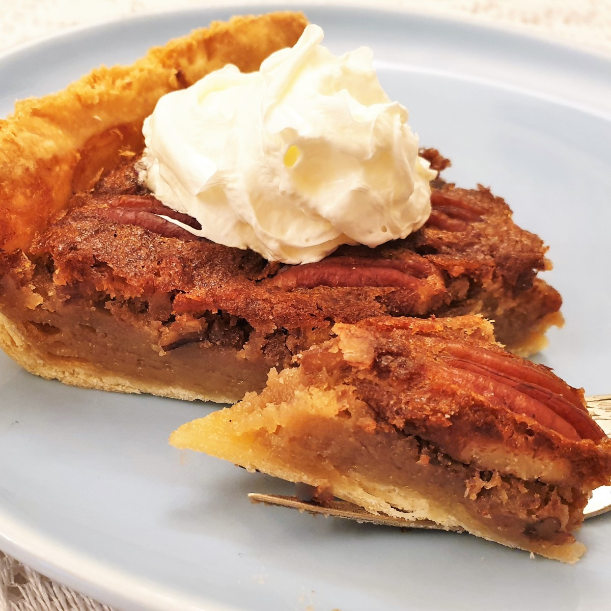 A slice of pecan nut pie on a plate.