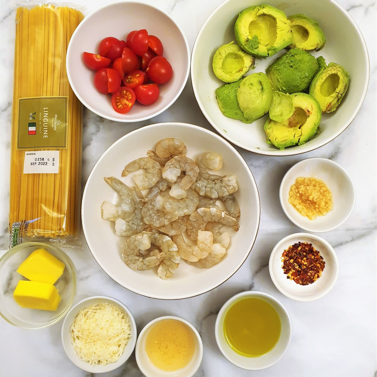 Ingredients for avocado and shrimp linguine.