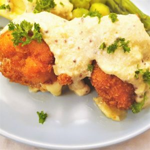 Crispy chicken cordon bleu covered with honey mustard sauce.