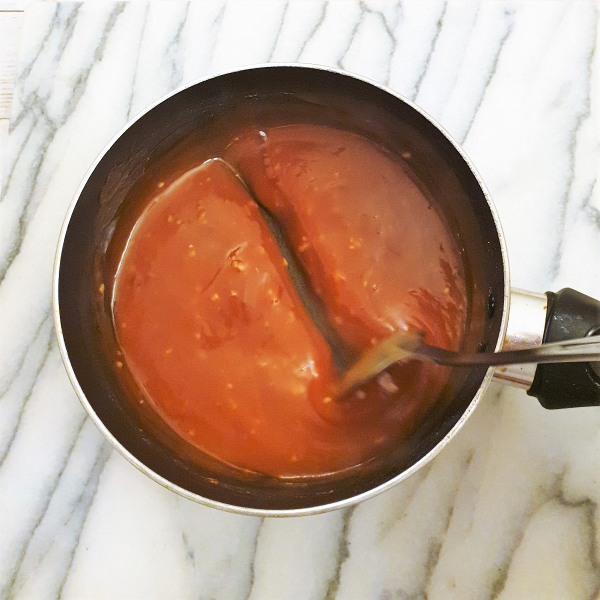 Overhead shot of sweet and sour sauce, showing consistency.