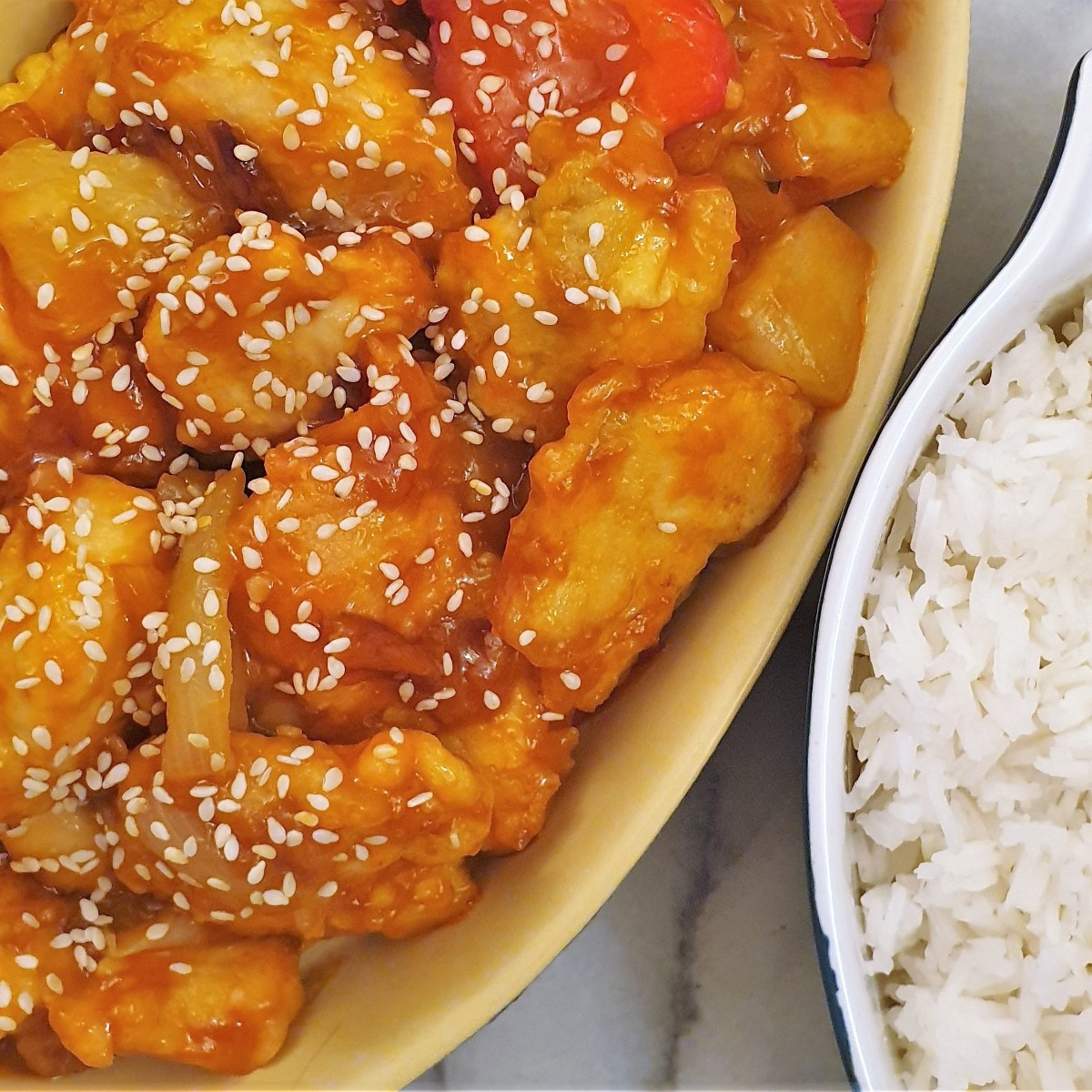 Close up of a dish of sweet and sour chicken.
