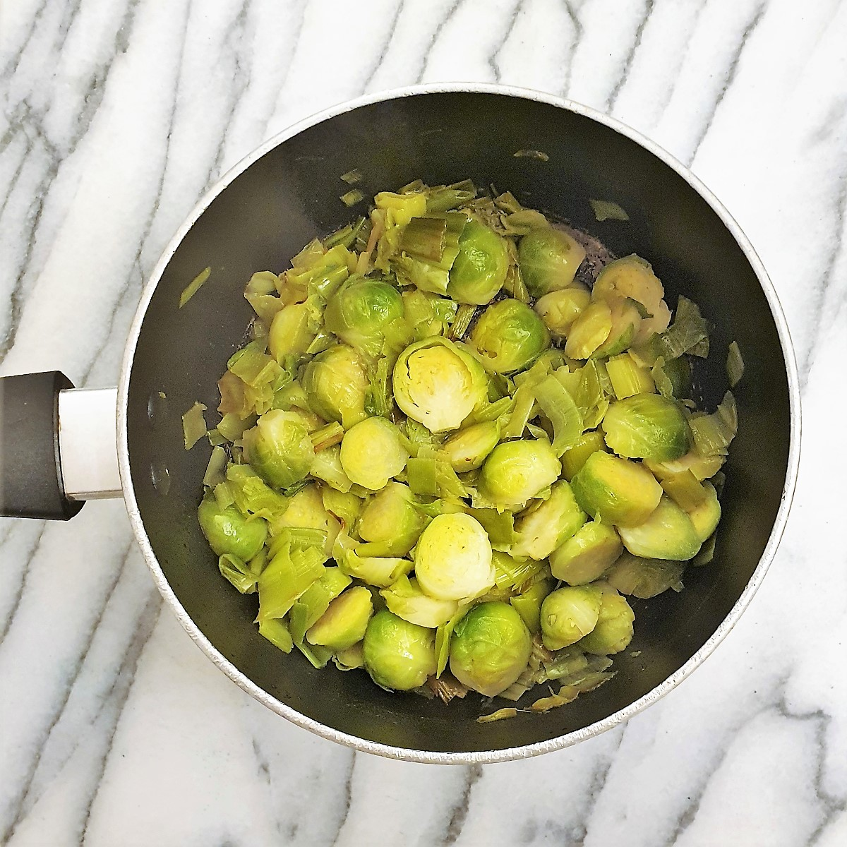 Add the brussels sprouts to the leeks.