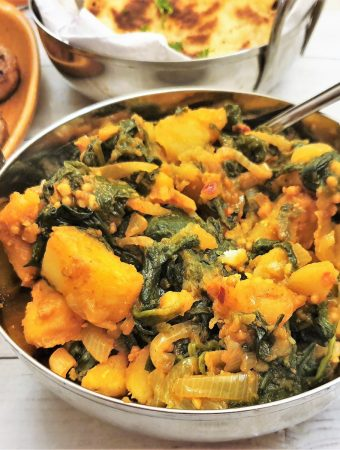 Close up of a balti dish filled with saag aloo.