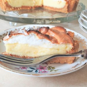 Close up of a slice of key lime pie on a plate.