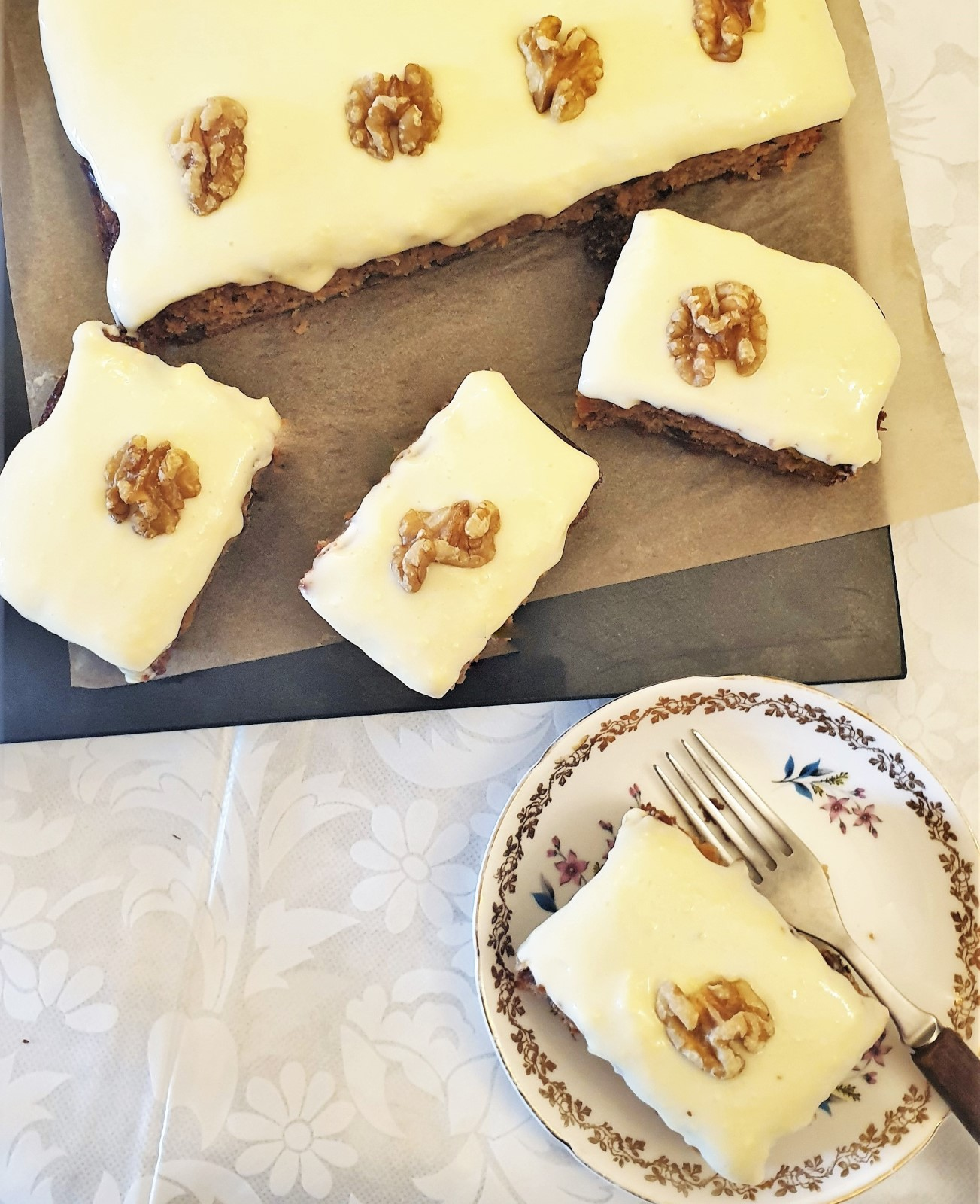 Overhead shot of slices of carrot and walnut cake.
