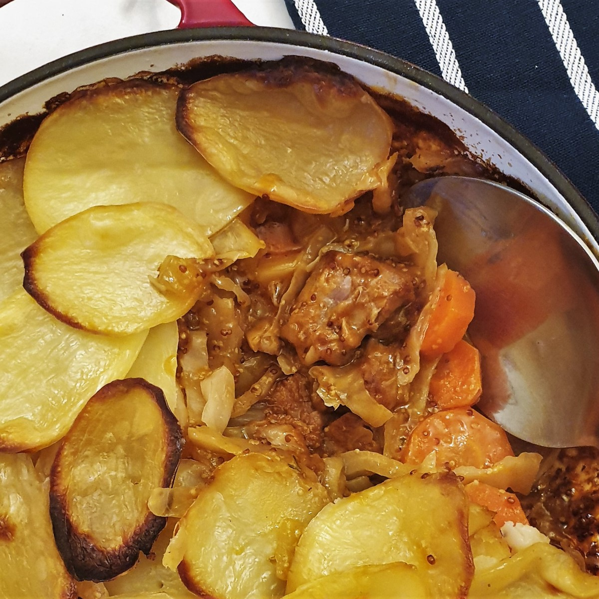 Close up of the meat and vegetables in the pork and cabbage casserole.