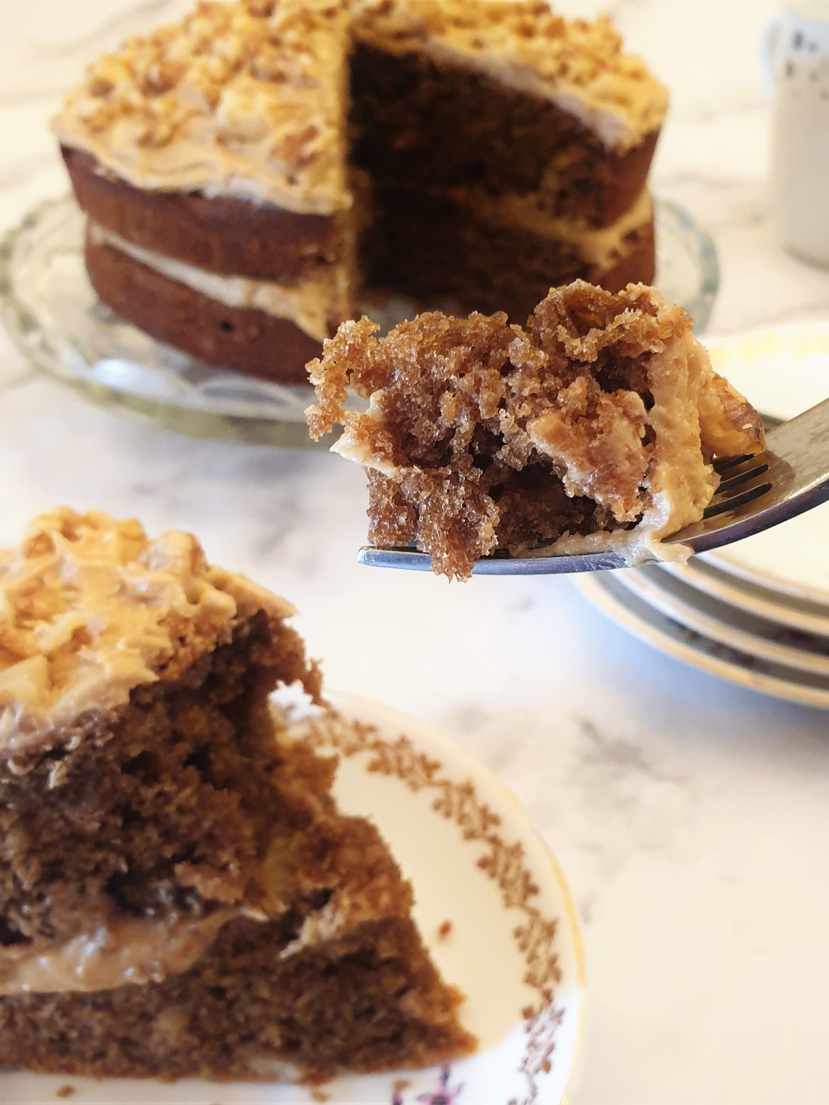 A forkful of coffee walnut cake.