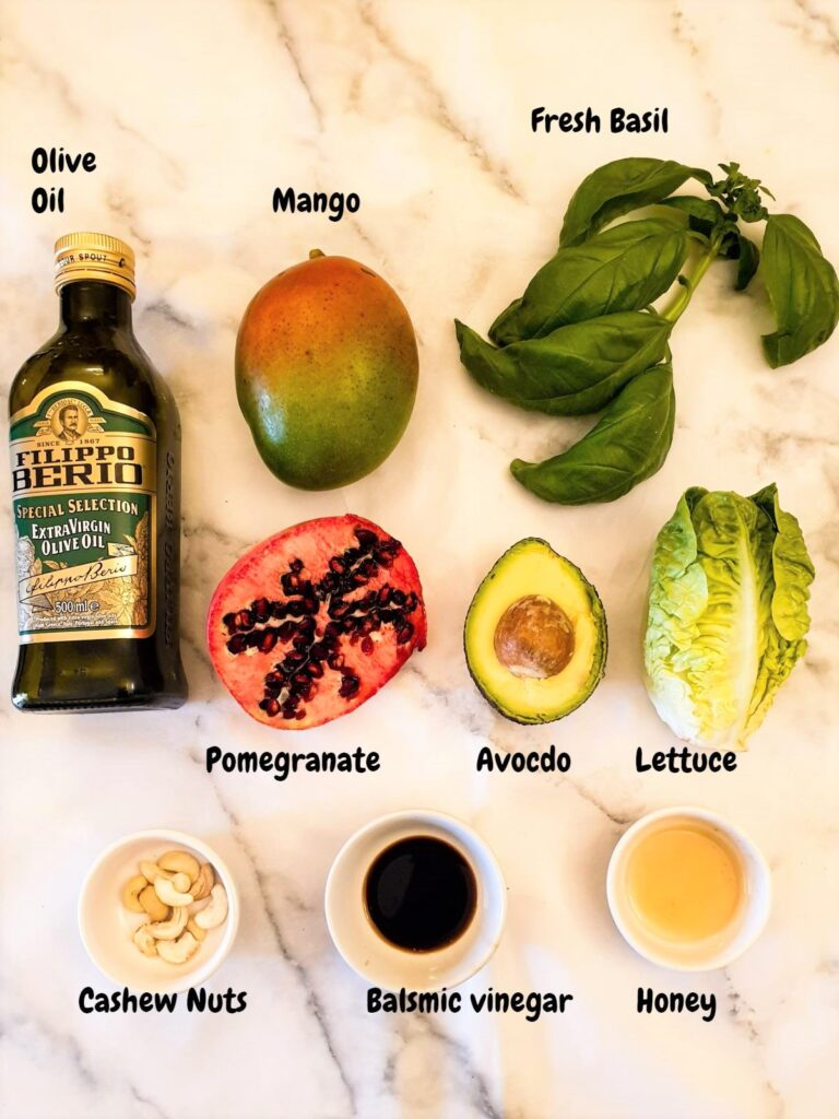 Ingredients for mango and avocado salad with cashews.