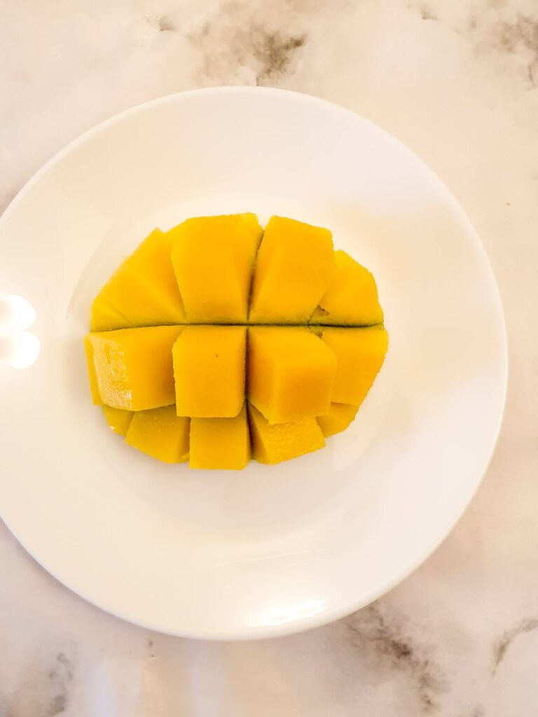 Half a mango cut into cubes.