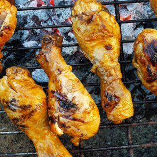 Chicken drumsticks on the barbeque grill.