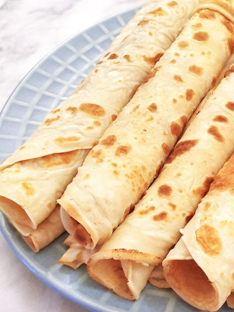 Closeup of rolled pancakes.