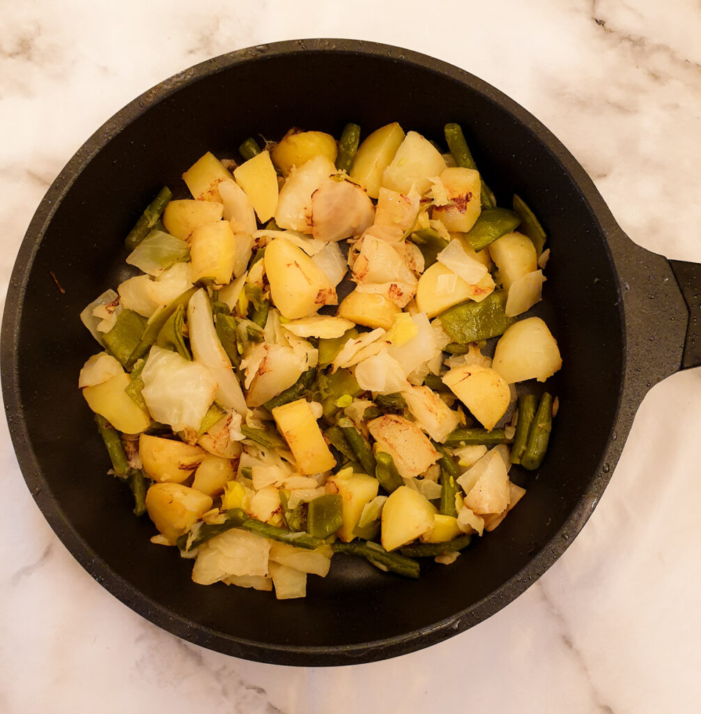 Bubble and squeak frying in a pan.