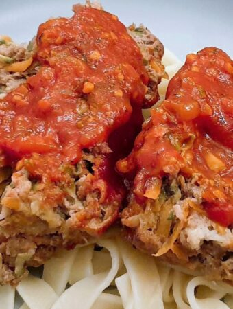 Slices of meatloaf on a bed of pasta, smothered with delicious marinara sauce.
