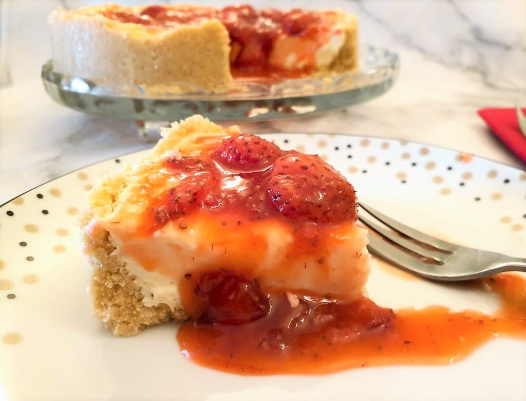Strawberry cheesecake oozing with syrupy strawberries.