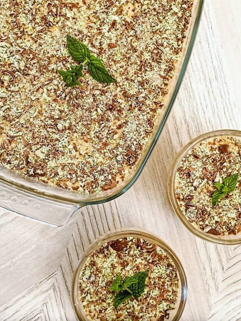 Overhead shot of a dish of peppermint crisp fridge tart next to two smaller individual dishes.