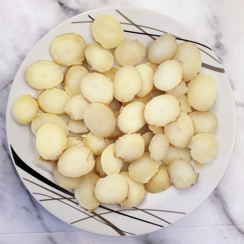 Slices of boiled potatoes on a plate.