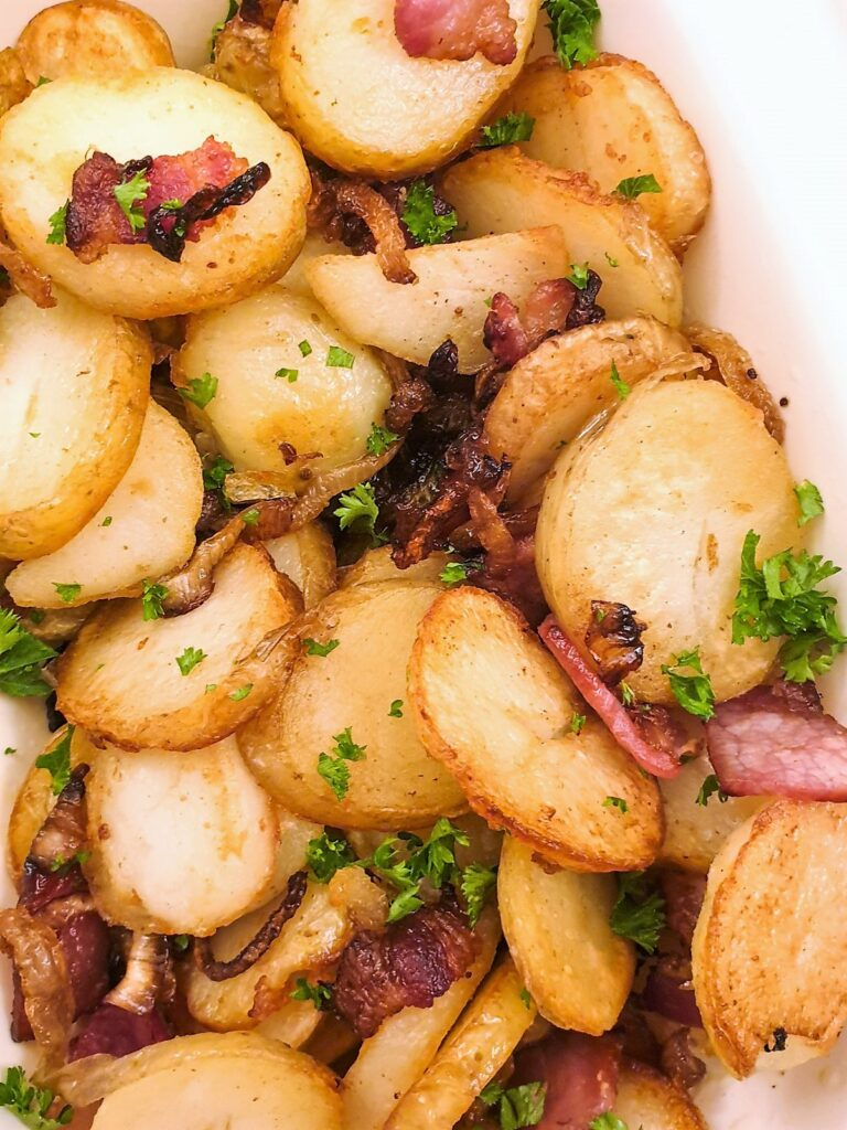 Close up of German fried potatoes with bacon and onion
