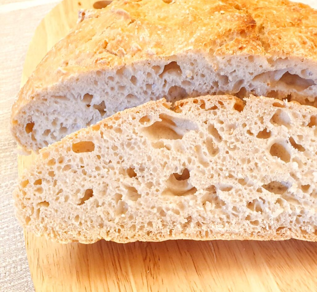 Close up of a slice of crusty homemade bread.