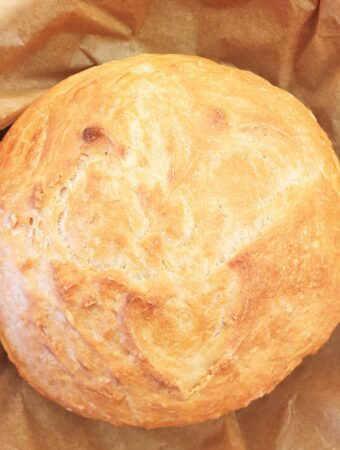 Overhead shot of a homemade loaf of crusty homemade bread.