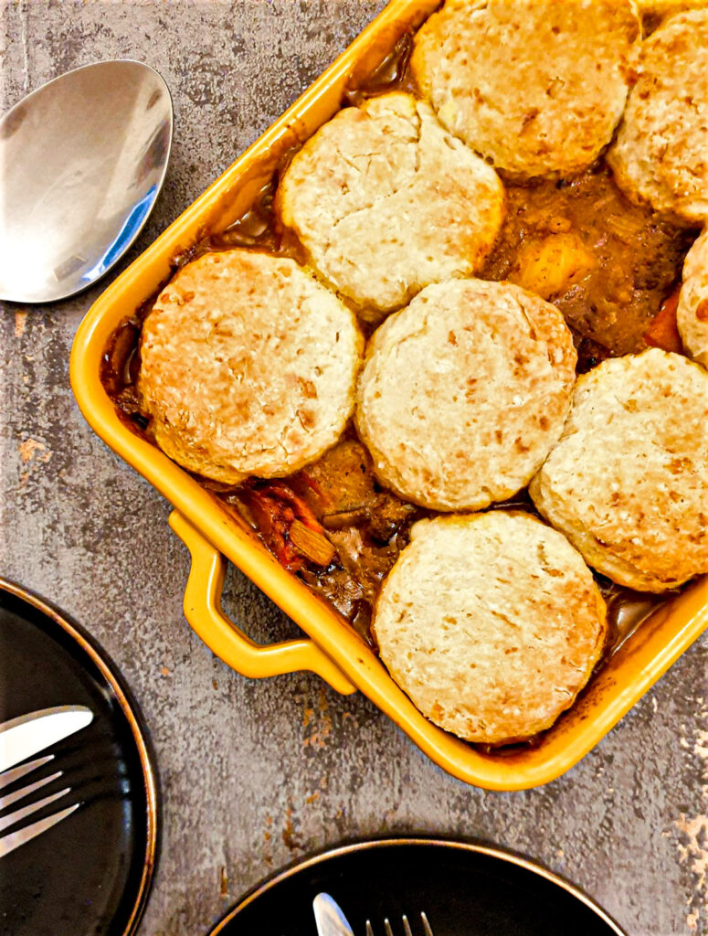 Overhead shot of beef cobbler, covered with cheese scones.
