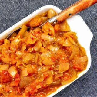 Closeup of a dish of chilli tomato and onion sauce.